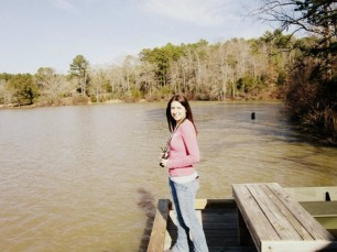 Sarah Sturtevant explores the boathouse area at Chester State Park.