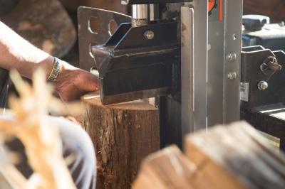 Richard Kinard splits wood as a hobby since retirement.